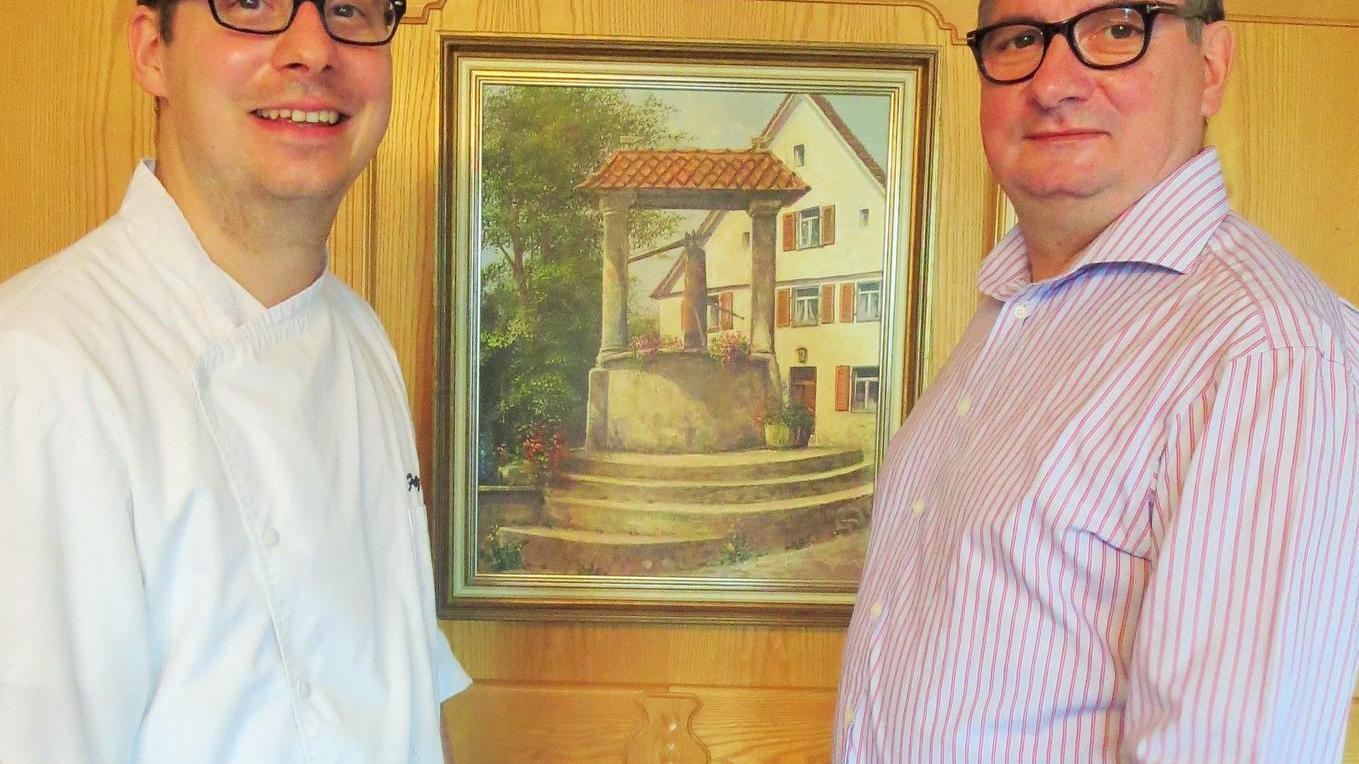 """Vater und Sohn: Die Familie Striegel vom """"Alten Brunnen""""."""