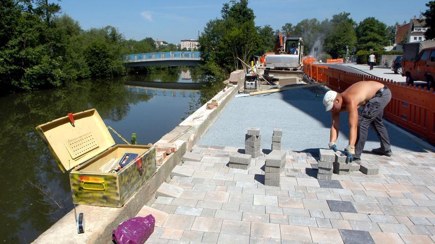Plasterarbeiten auf der Uferpromenade.
