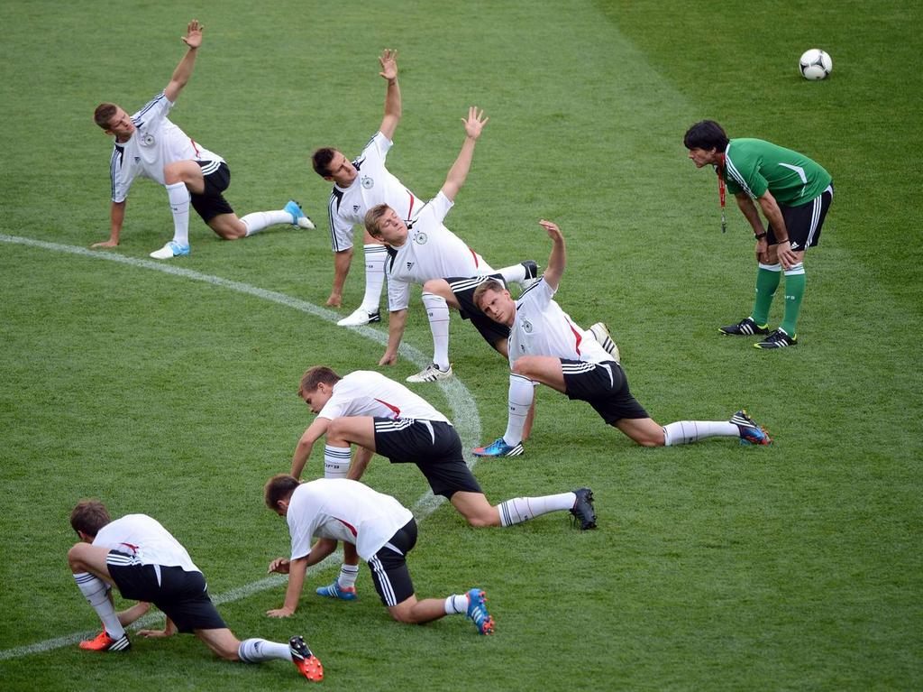 Germany's national football team headcoach Joachim Loew (R) and players attend  a training session on June 8, 2012 at the Arena stadium in Lviv, one the eve of  their Euro 2012 football championships match against Portugal. AFP PHOTO /  ANNE-CHRISTINE POUJOULAT