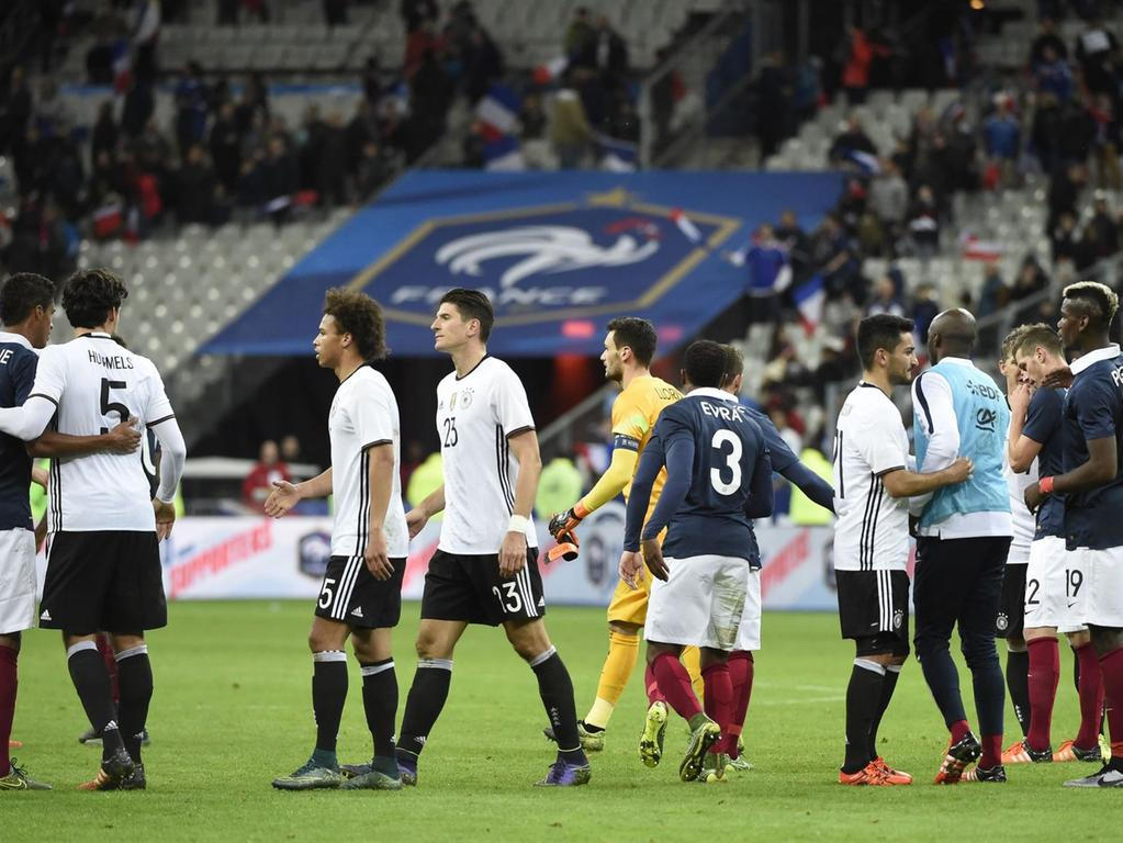 (From L) French defender Raphael Varane, Germany's defender Mats Hummels,  Germany's midfielder Leroy Sane and Germany's forward Mario Gomez, French  defender Patrice Evra, Germany's midfielder Ilkay Gundogan and French  midfielder Paul Pogba (R) embrace after France defeated Germany 2-0 in their  friendly international football match ahead of the Euro 2016, on November 13,  2015 at the Stade de France stadium in Saint-Denis, north of Paris. AFP PHOTO /  MIGUEL MEDINA