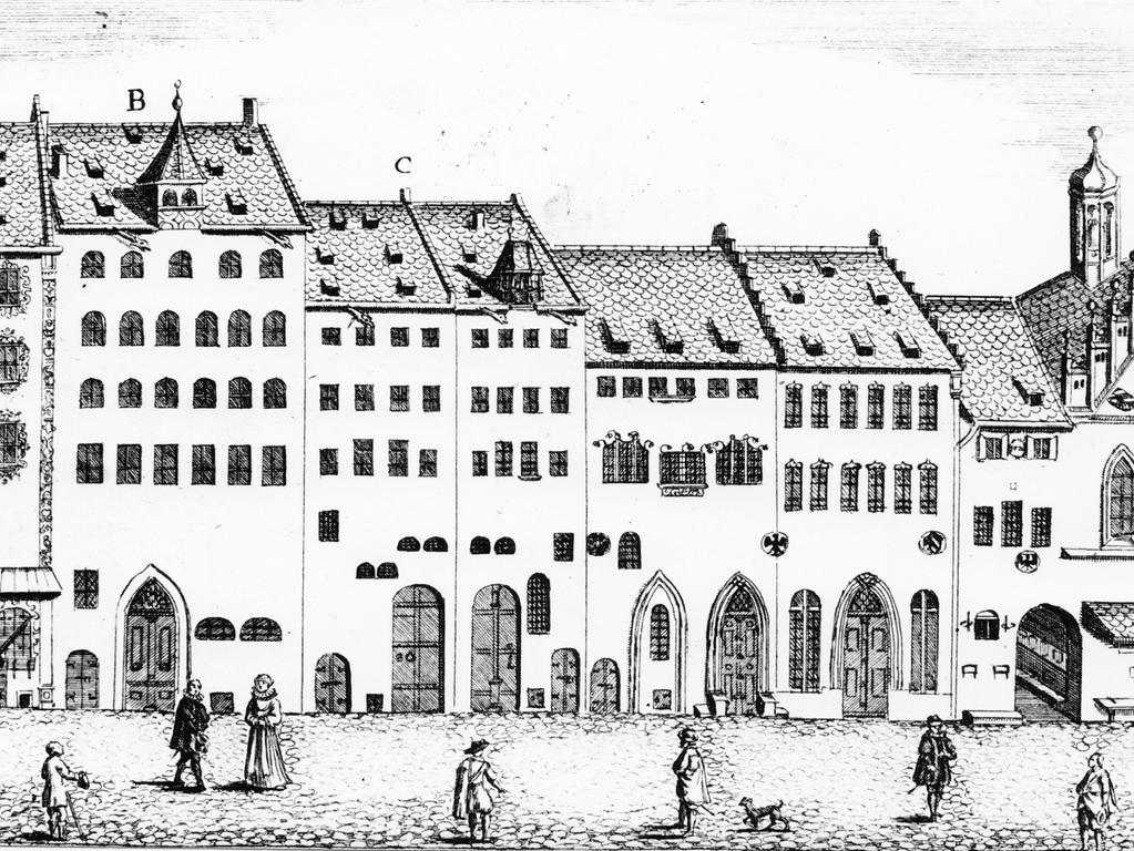 Ein alter Stich von 1614 zeigt die Situation kurz vor der Grundsteinlegung. Bürgerhäuser (B: Hanns Boschen Hauß) standen am Platz des späteren Wolff'schen Baus. Rechts: die Fassade des großen Rathaus-Saales, die von der langgestreckten Renaissance-Front verschluckt worden ist.