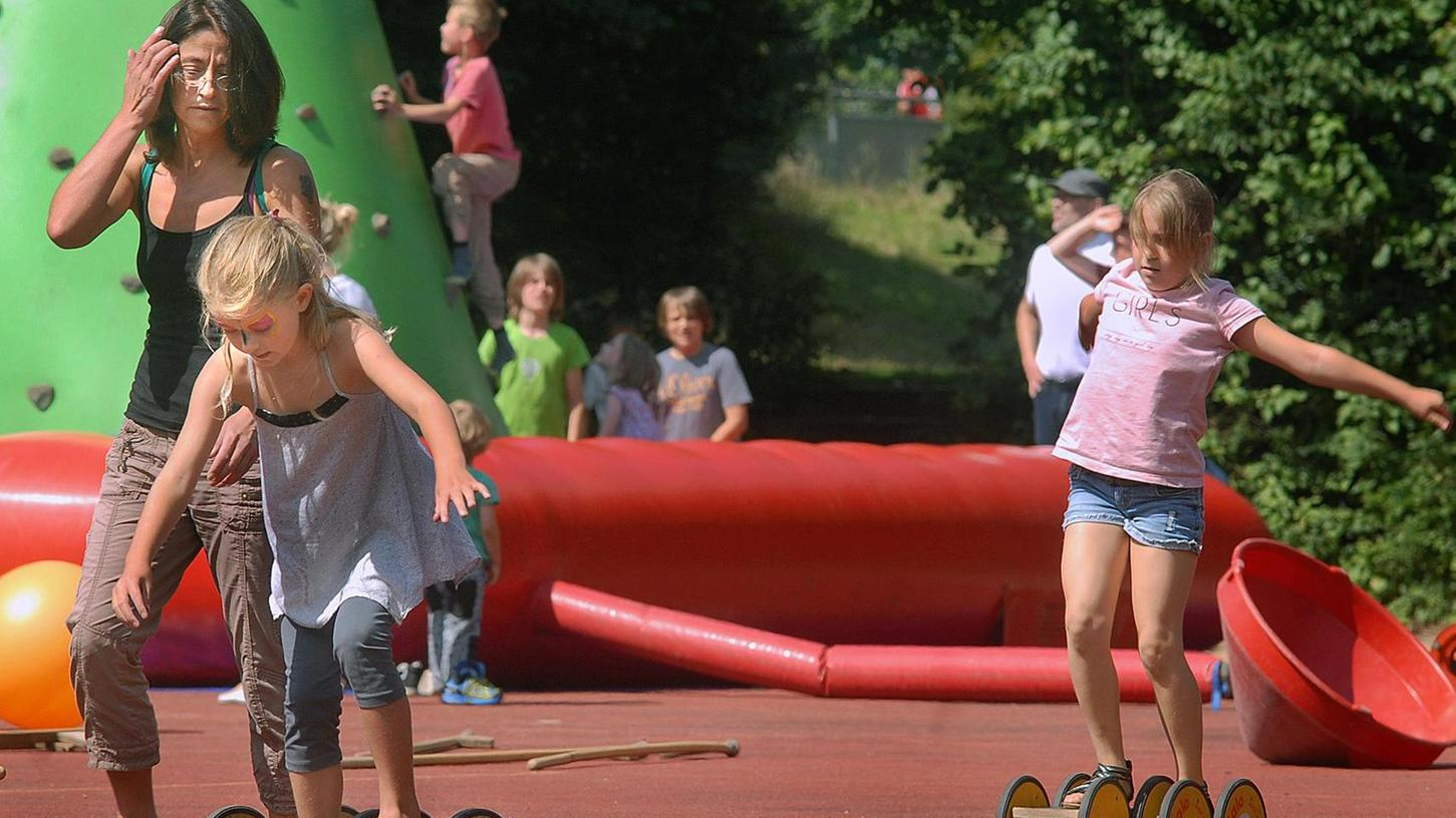 Für Uttenreuths Kinder - hier beim Sommerferienfest - sollen die Unterbringungsmöglichkeiten in den Tagesstätten erschwinglich bleiben.