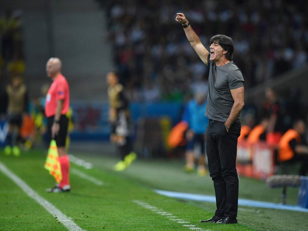 Germany's coach Joachim Loew reacts during the Euro 2016 group C football match  between Germany and Ukraine at the Stade Pierre Mauroy in Villeneuve-d'Ascq  near Lille on June 12, 2016. / AFP PHOTO / MARTIN BUREAU