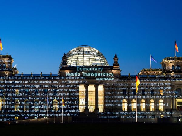 """TOPSHOT - Handout picture taken on early May 2, 2016 shows a lettering reading  """"Democracy needs Transparency"""" displayed by Greenpeace activists on the  Reichstag Building in Berlin housing the Bundestag (lower house of parliament)  in order to protest against the planned TTIP free trade pact between the  European Union and the US..Greenpeace published documents showing that the  Transatlantic Trade and Investment Partnership (TTIP) poses """"major risks for  climate, environment and consumer safety"""". / AFP PHOTO / Greenpeace Germany /  Daniel MUELLER / RESTRICTED TO EDITORIAL USE - MANDATORY CREDIT """"AFP PHOTO /  GREENPEACE"""" - NO MARKETING NO ADVERTISING CAMPAIGNS - DISTRIBUTED AS A SERVICE  TO CLIENTS == NO ARCHIVE. / .IMAGE AVAILABLE FOR DOWNLOAD AND PUBLICATION BY  EXTERNAL MEDIA UNTIL 15/05/2016. TERMS OF DELIVERY: NO THIRD PARTIES, NO  RESALE, NO ARCHIVE, FOR EDITORIAL USE ONLY, NOT FOR MARKETING OR ADVERTISING  CAMPAIGNS. CREDIT-LINE COMPULSORY"""