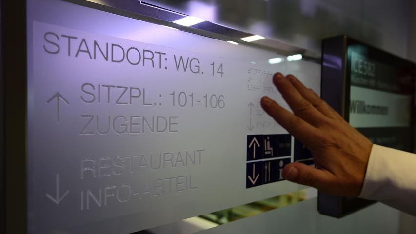 A man palpates information in Braille on a door of a new ICE 4 high speed train of German railway operator Deutsche Bahn in Berlin on September 13, 2016..Deutsche Bahn is presenting the new, fourth generation model of it's Inter City Express (ICE) high speed train, that the company plans to put into servic in December 2017. / AFP PHOTO / TOBIAS SCHWARZ