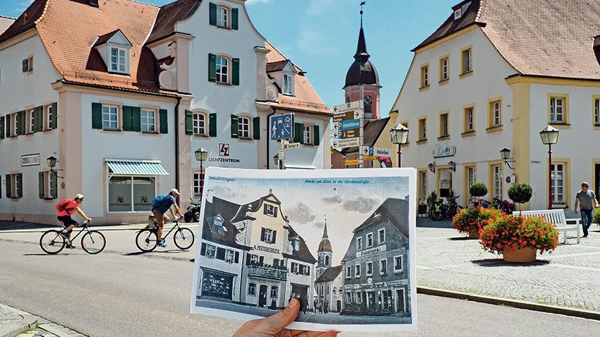 """Ochse, Lamm, Bär und Sonne – das sind die ältesten Gastwirtschaften der Altmühlstadt. Alle vier sind zwar erst ab dem 19. Jahrhundert sicher belegt, das Volkskundemuseum nimmt aber an, dass dort bereits zu Zeiten der Markterhebung Treuchtlingens um das Jahr 1364 Bier gebraut und ausgeschenkt wurde. Erstmals erwähnt wird das einstige Gasthaus """"Zum Ochsen"""" (links im Bild) im Jahr 1617. Endres Böck hieß der damalige Besitzer. 1858 gründete Alois Neuburger in dem Gebäude am heutigen Rathausplatz eine Eisenwarenhandlung. Unser """"Bild im Bild"""" zeigt sie auf einer historischen Postkarte aus dem späten 19. Jahrhundert. Zuvor hatte der """"Ochs"""" als Zunftlokal sowie """"gewöhnliche Herberg"""" der Schreiner, Zimmerer, Glaser und Schlosser gedient. Diese zogen nach dem Verkauf in die """"Sonne"""" um – das heutige Verlagsgebäude des Treuchtlinger Kuriers. Später residierte der Eisen- und Sanitärgroßhandel Bohner in dem Haus in der Hauptstraße 28, bevor die Firma ins Gewerbegebiet Neufriedenheim zog. Heutiger Nutzer ist das """"Lichtzentrum""""."""