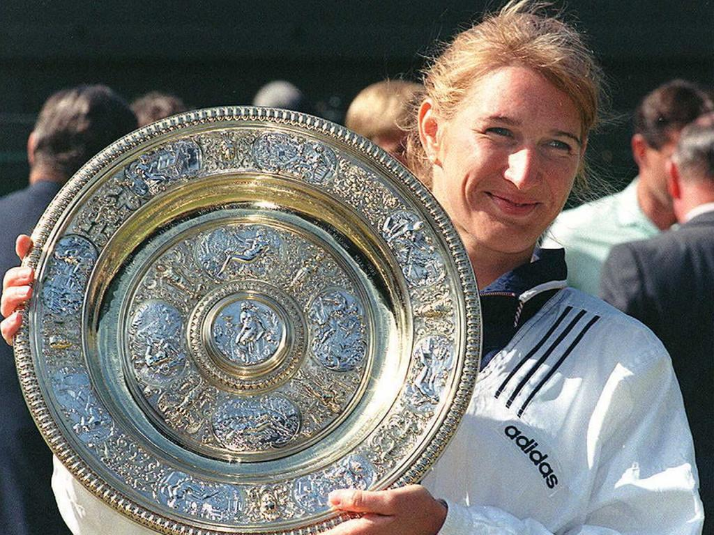 German top seed Steffi Graf holds her trophy after she won her seventh title after beating Arantxa Sanchez Vicario of Spain in the women 's singles final at the Wimbledon Tennis Championships 06 July. Graf won 6-3, 7-5.. AFP PHOTO/Gerry PENNY / AFP PHOTO / GERRY PENNY