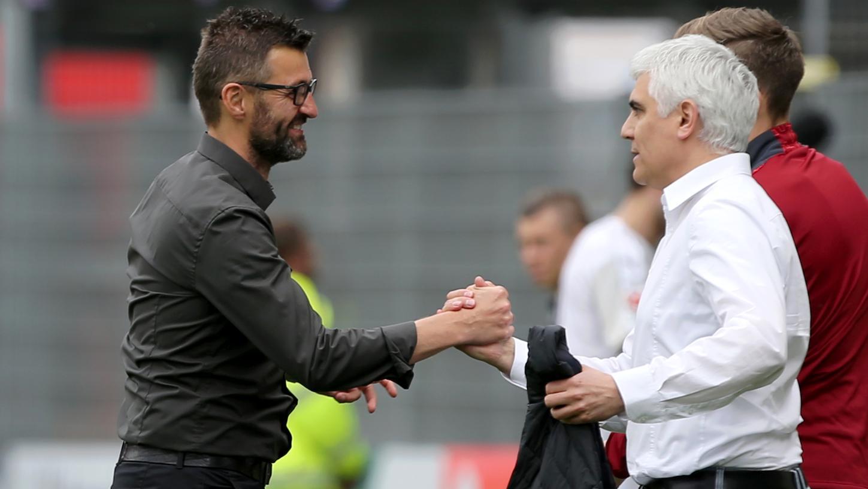 Lange hielt Andreas Bornemann (re.) an Michael Köllner fest, nun spielen beide keine Rolle mehr in der sportlichen Zukunft des 1. FC Nürnberg.