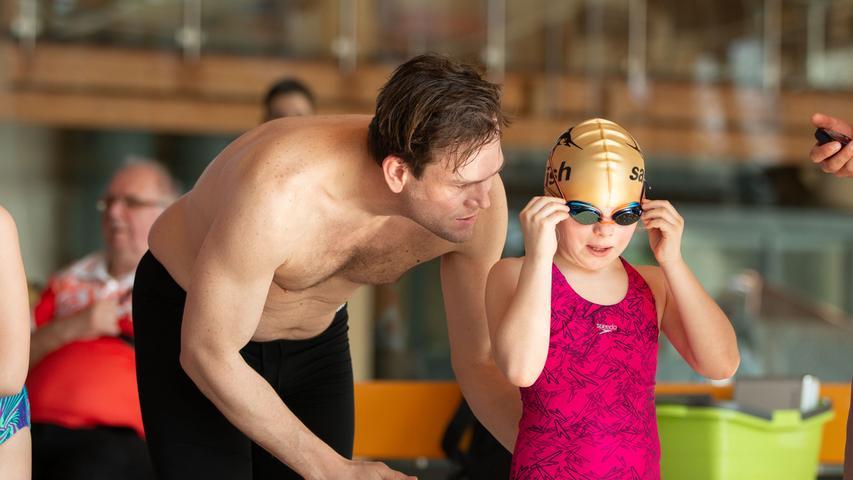 Swim and run, Forchheim Zu sehen sind in Bild 12 der Sieger bei den Herren (Startnummer 164) und auf Bild 13 die Siegerin (Startnummer 165). Fotos: Felix Grampp; Datum: 31.03.2019