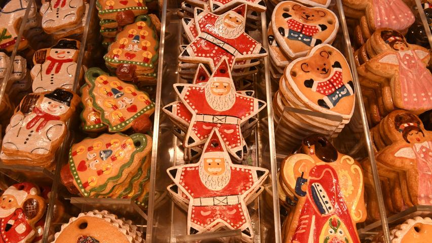 Decorated Christmas gingerbreads are displayed for sale at the traditional Christmas Market in Nuremberg, southern Germany, on November 29, 2019. - The traditional