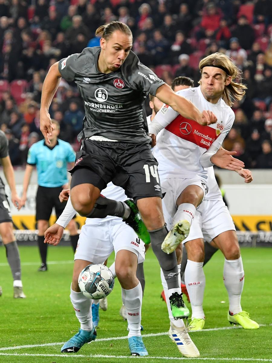 09.12.2019 --- Fussball --- Saison 2019 2020 --- 2. Fussball - Bundesliga --- 16. Spieltag: VfB Stuttgart - 1. FC Nürnberg Nuernberg FCN ( Club ) --- Foto: Sport-/Pressefoto Wolfgang Zink / WoZi --- .DFL regulations prohibit any use of photographs as image sequences and/or quasi-video ---...Michael Frey (14, 1. FC Nürnberg / FCN ) Borna Sosa (24, VfB Stuttgart )