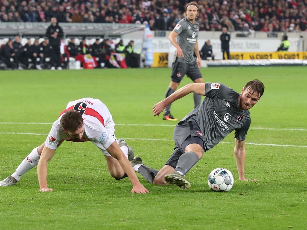 09.12.2019 --- Fussball --- Saison 2019 2020 --- 2. Fussball - Bundesliga --- 16. Spieltag: VfB Stuttgart - 1. FC Nürnberg Nuernberg FCN ( Club ) --- Foto: Sport-/Pressefoto Wolfgang Zink / DaMa --- ..DFL regulations prohibit any use of photographs as image sequences and/or quasi-video ---......Nathaniel Phillips (5, VfB Stuttgart ) Asger Sörensen (4, 1. FC Nürnberg / FCN )