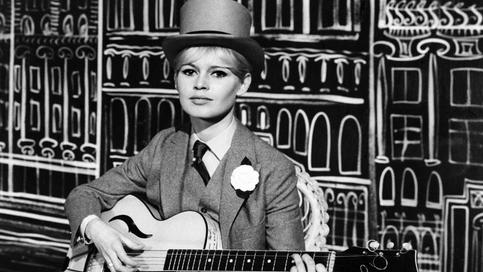"""Picture released on December 19, 1961 of French actress Brigitte Bardot singing """"Sunny side of the street"""" during a rehearsal of the TV programm at the RTF studios, in Paris. At the eve of the January 1, 1962, Brigitte Bardot will perform four songs to wish viewers an """"Happy New Year""""."""