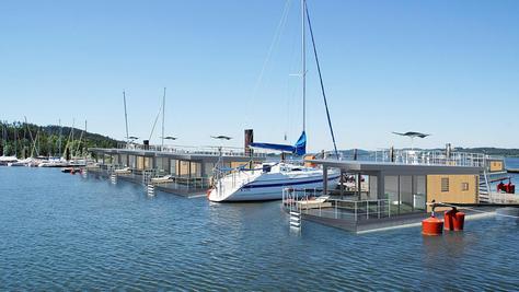So sehen die schwimmenden Häuser auf dem Brombachsee aus: Terrasse, Dachterrasse, Bootsanlegeplatz — auch das kleine Modell Floating 44 bietet dem künftigen Seenland-Urlauber schon viel Komfort.