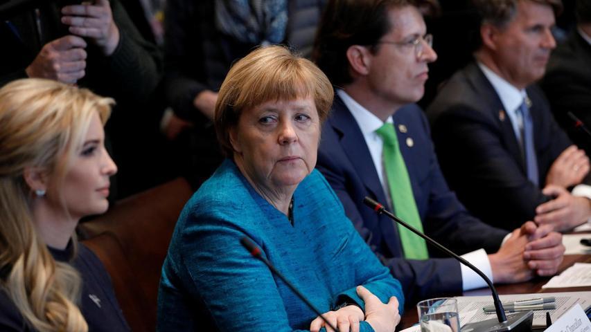 Augenblicke: Angela Merkel hat keine Augen für Klaus Rosenfeld (grüne Krawatte), sondern mustert neugierig Ivanka Trump.